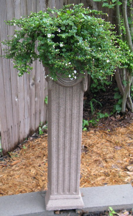 This is the column as seen from the garden.  It is on the outside wall of the outside bed of the labyrinth.